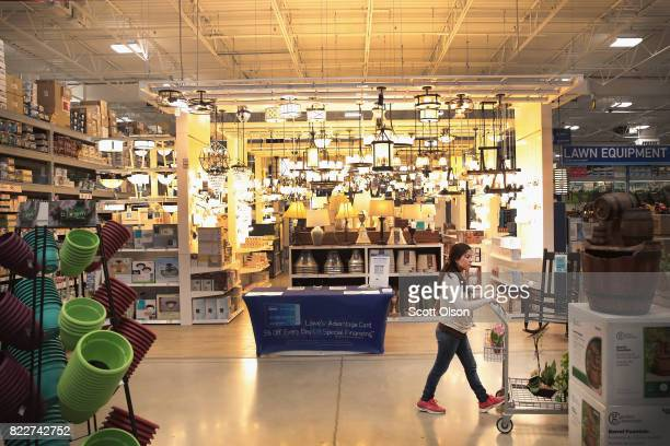 Customers shop at a Lowe's home improvement store on July 25 2017 in Chicago Illinois A shortage of new singlefamily homes in the US is causing many...