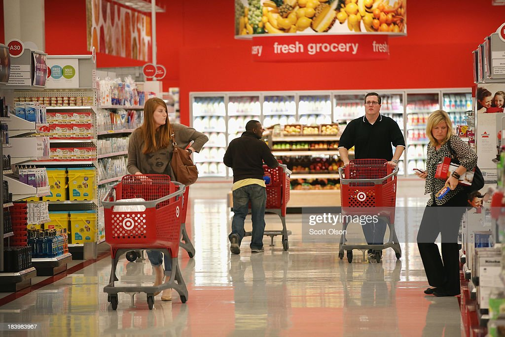 Customers shop at a Target store on October 10, 2013 in Chicago, Illinois. The store, which opened on October 8, was built on land where the notorious Cabrini-Green housing project once stood. The last of the Cabrini-Green high-rise homes were demolished two years ago. The housing project has been replaced with townhomes and retail shops, with some of the property being left vacant.