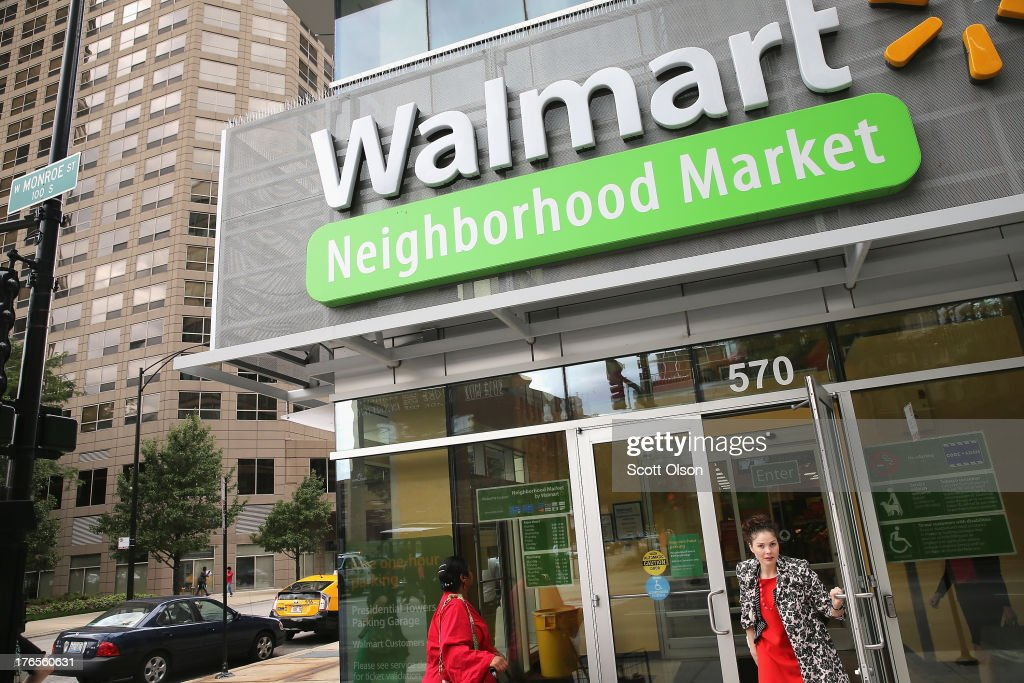 Customers shop at a Walmart Neighborhood Market store on August 15, 2013 in Chicago, Illinois. Walmart, the world's largest retailer, reported a surprise decline in second-quarter same-store sales today. The retailer also cut its revenue and profit forecasts for the fiscal year.