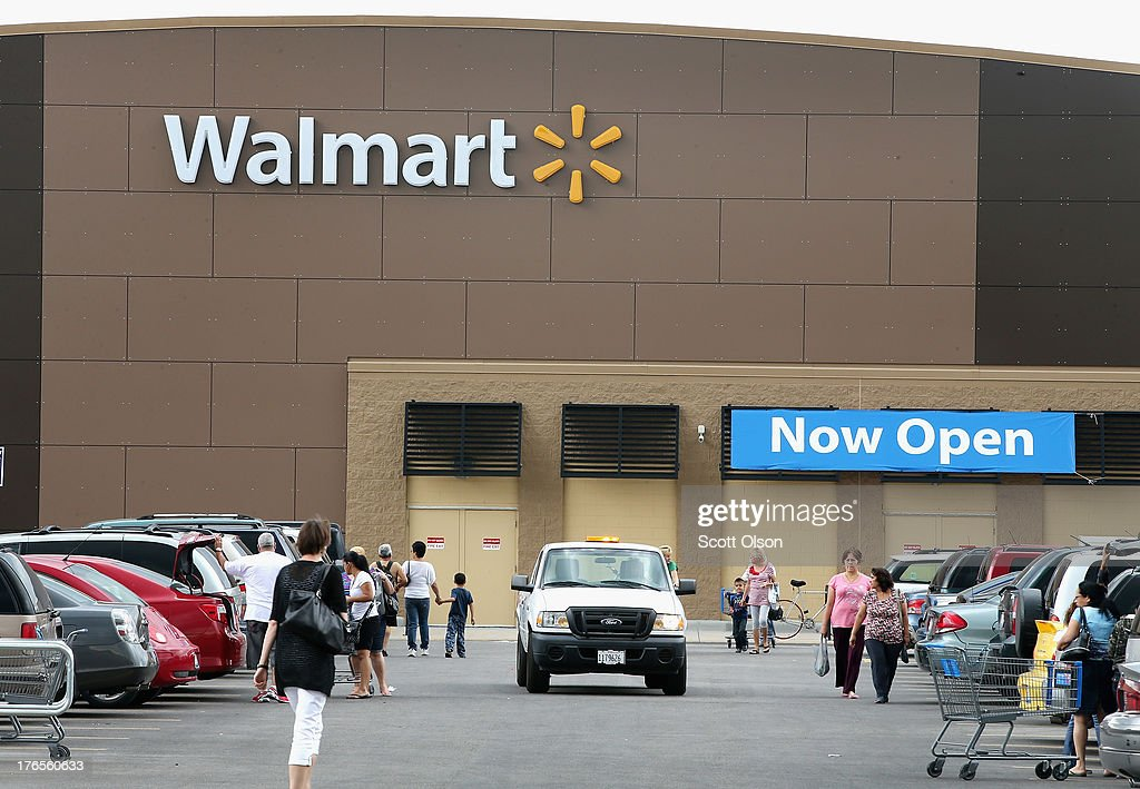 Customers shop at a Walmart store on August 15, 2013 in Chicago, Illinois. Walmart, the world's largest retailer, reported a surprise decline in second-quarter same-store sales today. The retailer also cut its revenue and profit forecasts for the fiscal year.