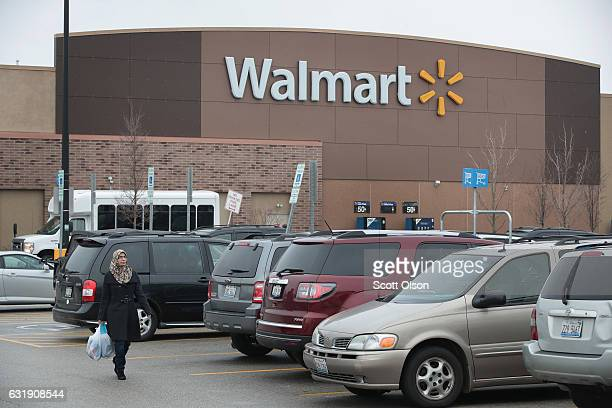Customers shop at a Walmart store on January 17 2017 in Skokie Illinois WalMart Stores Inc the nation's largest employer announced today that it...