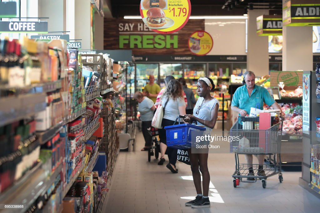 Customers shop at an Aldi grocery store on June 12, 2017 in Chicago, Illinois. Aldi has announced plans to open 900 new stores in the United States in the next five years. The $3.4 billion capital investment would create 25,000 jobs and make the grocery chain the third largest in the nation behind Wal-Mart and Kroger.