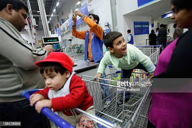 Customers shop at Best Price a whole sale store owned jointly by Walmart and Bharti Enterprise in Jalandhar India on November 30 2011 Indian...