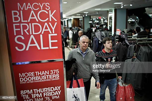 Customers shop at Macy's Herald Square after the store opened its doors at 8 pm Thanksgiving day on November 28 2013 in New York City Black Friday...