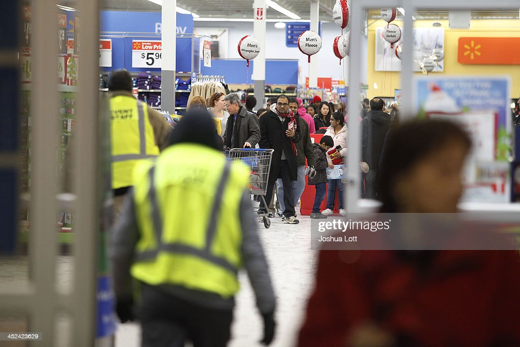 Customers shop at Wal-Mart Thanksgiving day on November 28, 2013 in Troy, Michigan. Black Friday shopping began early this year with most major retailers opening their doors on Thanksgiving day as consumers took advantage of discounted prices to prepare for the holiday season.
