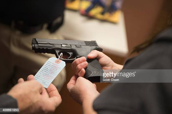 Customers shop for a handgun at Metro Shooting Supplies on November 12 2014 in Bridgeton Missouri The suburban St Louis store is located near...
