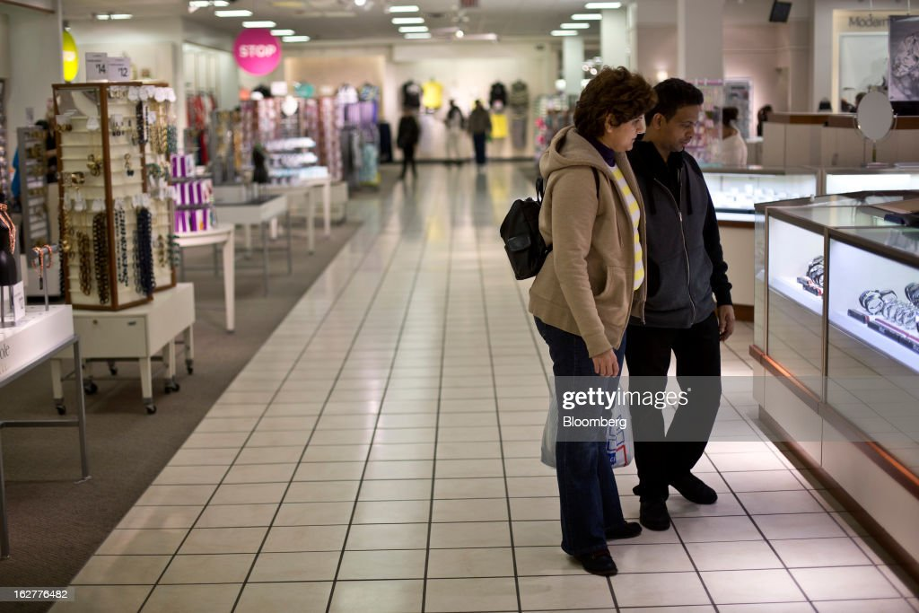 Customers shop for accessories at a J.C. Penney Co. store in the Queens borough of New York, U.S., on Tuesday, Feb. 26, 2013. Confidence among U.S. consumers jumped more than forecast in February as Americans adjusted to a higher payroll tax and signs of a recovering housing market spurred faith in the future. J.C. Penney Co. is scheduled to release earnings data on Feb. 27. Photographer: Victor J. Blue/Bloomberg via Getty Images
