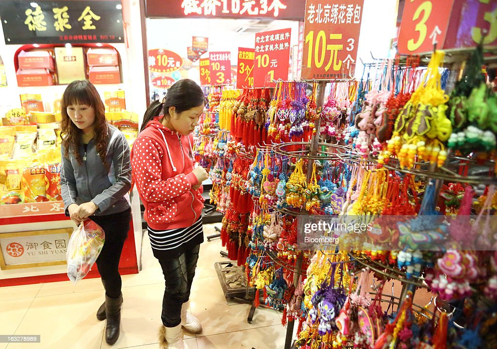 Customers shop for accessories at a store in Beijing, China, on Wednesday, March 6, 2013. China maintained its economic-growth target at 7.5 percent for 2013 while setting a lower inflation goal of 3.5 percent, setting up a challenge for new leaders to keep prices in check without harming expansion. Photographer: Tomohiro Ohsumi/Bloomberg via Getty Images