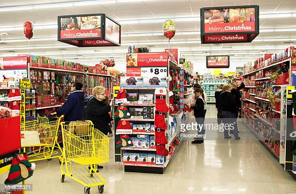 Customers shop for Christmas items at a Dollar General Corp store in Saddle Brook New Jersey US on Saturday Dec 3 2011 Dollar General is scheduled to...