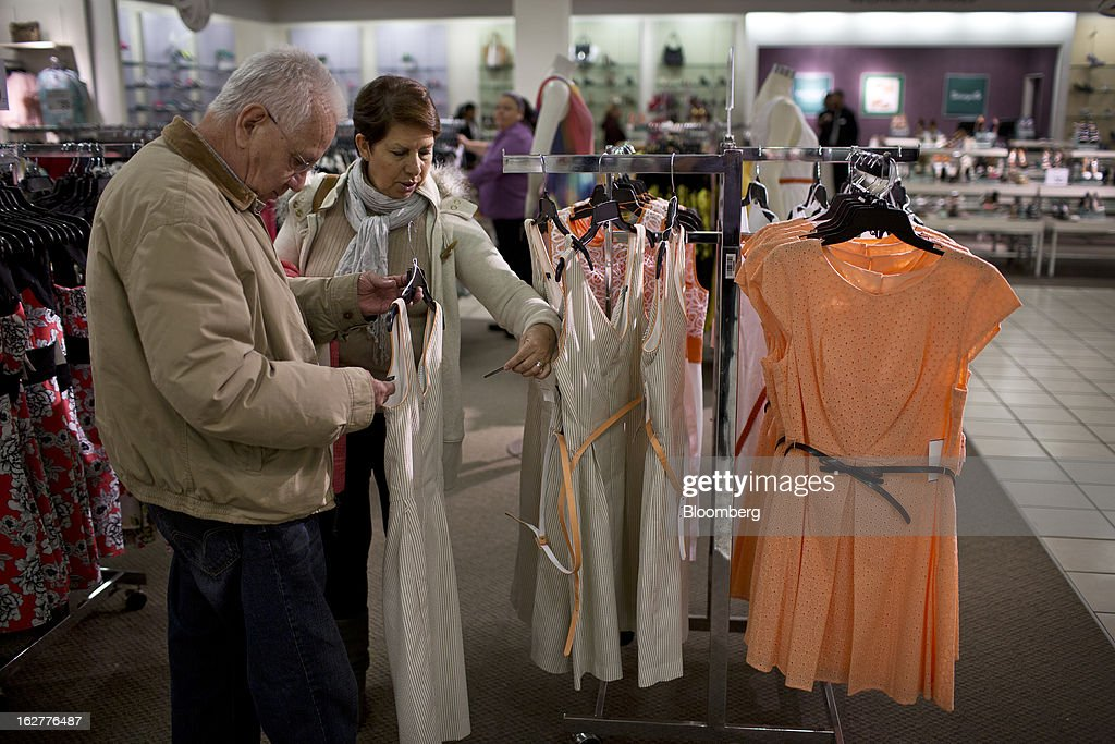 Customers shop for clothing at a J.C. Penney Co. store in the Queens borough of New York, U.S., on Tuesday, Feb. 26, 2013. Confidence among U.S. consumers jumped more than forecast in February as Americans adjusted to a higher payroll tax and signs of a recovering housing market spurred faith in the future. J.C. Penney Co. is scheduled to release earnings data on Feb. 27. Photographer: Victor J. Blue/Bloomberg via Getty Images