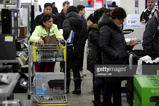 Customers shop for electronics and other items at a Best Buy on November 27 2015 in Skokie Illinois Many retail business across the country offer...