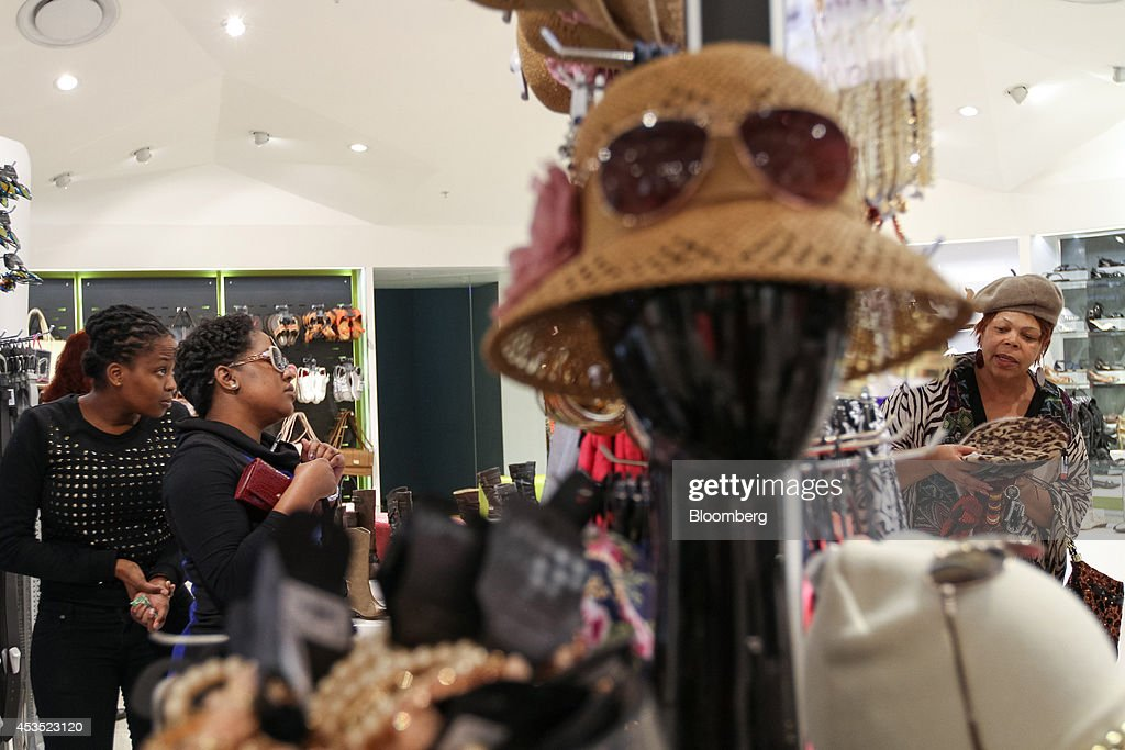 Customers shop for fashion accessories inside a Truworths International Ltd fashion store in Sandton South Africa on Tuesday Aug 12 2014 South...