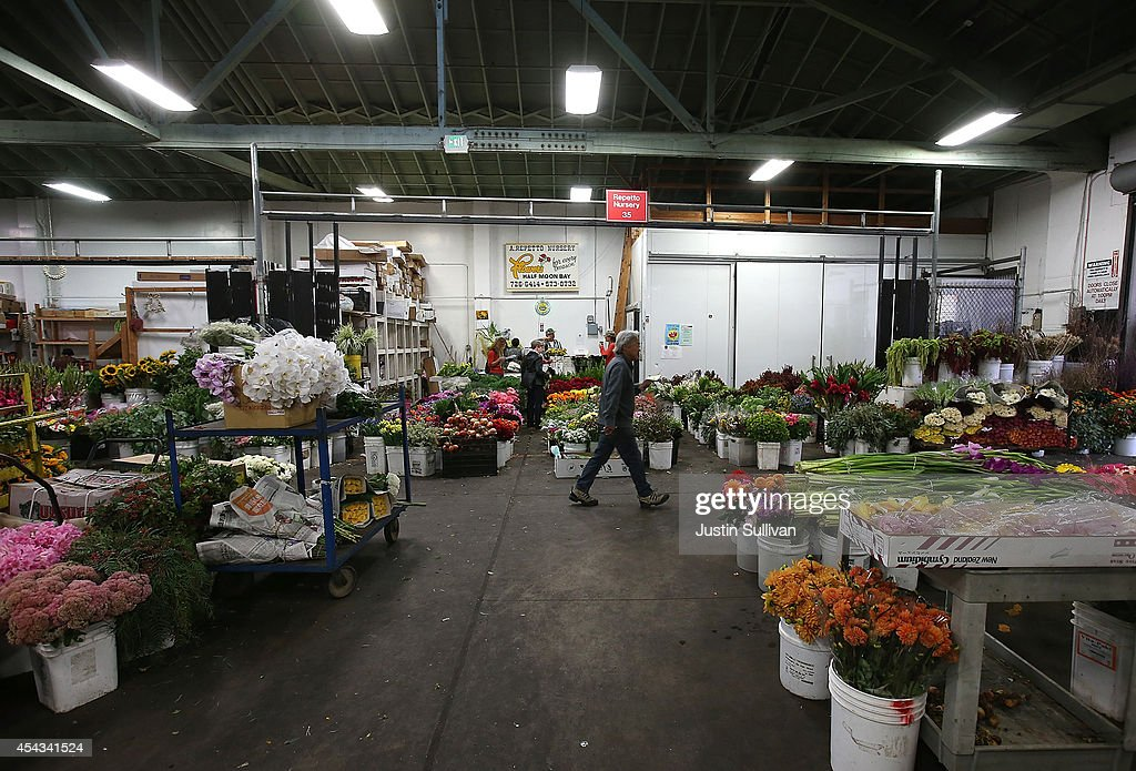 Customers shop for flowers at the San Francisco Flower Mart on August 29, 2014 in San Francisco, California. The future of more than 100 flower businesses at the historic San Francisco Flower Mart hangs in the balance as Los Angeles based realty group Kilroy Realty Corp. is planning on purchasing the Flower Mart property. Kilroy has proposed a plan to build a tech campus on the site.