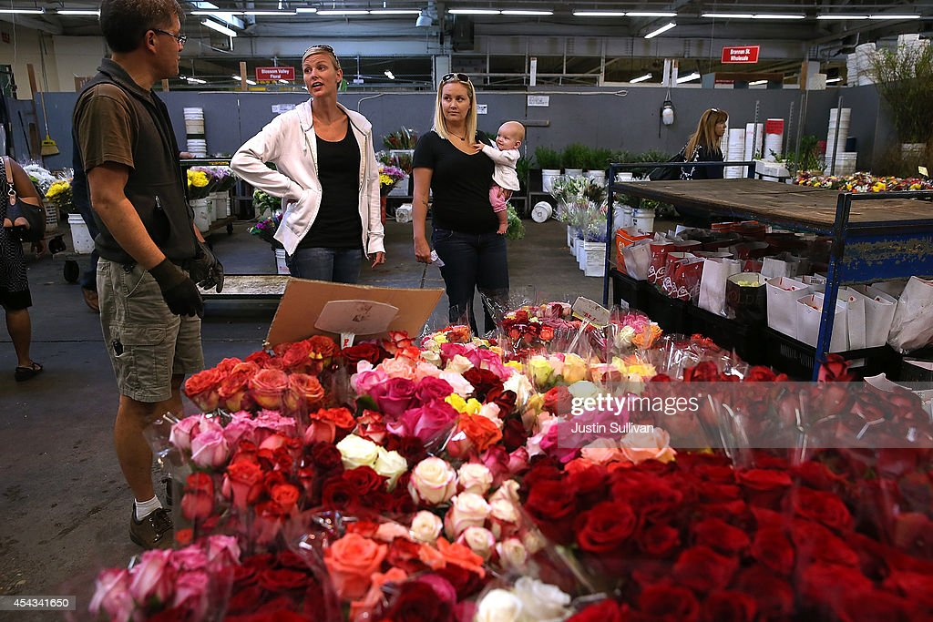 Customers shop for flowers at the San Francisco Flower Mart on August 28, 2014 in San Francisco, California. The future of more than 100 flower businesses at the historic San Francisco Flower Mart hangs in the balance as Los Angeles based realty group Kilroy Realty Corp. is planning on purchasing the Flower Mart property. Kilroy has proposed a plan to build a tech campus on the site.