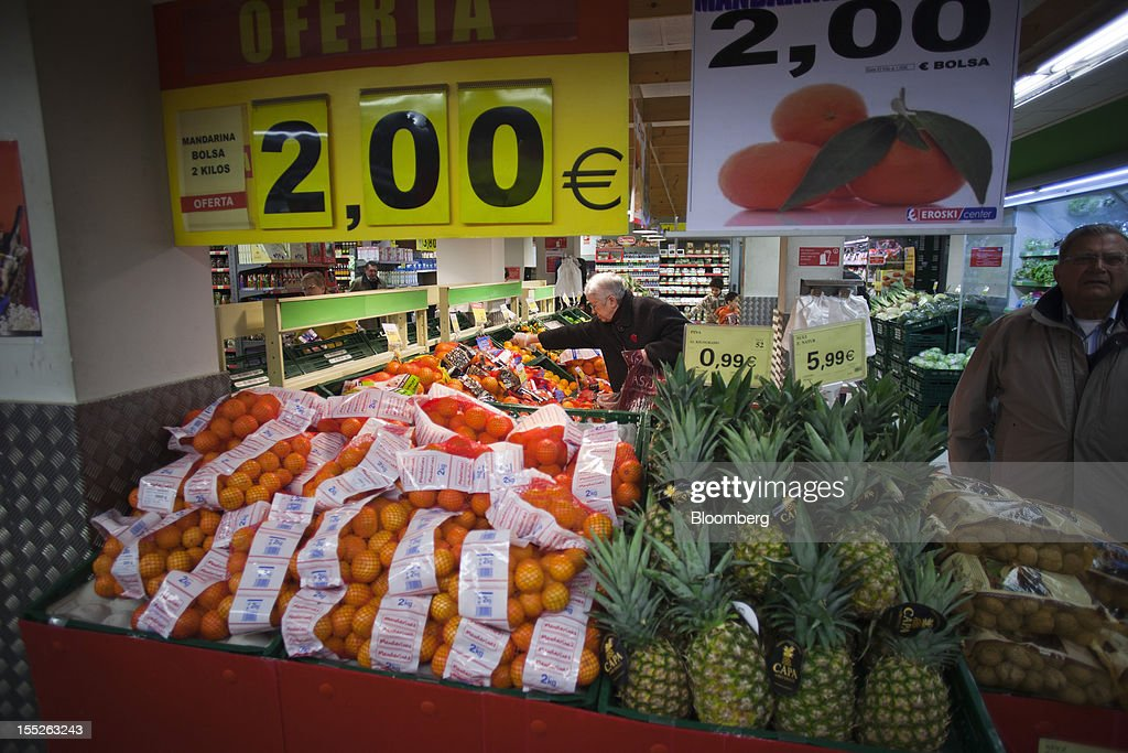 Customers shop for fresh fruit in the groceries section of an Eroski Group supermarket in Madrid, Spain, on Friday, Nov. 2, 2012. Spain is unlikely to need a full bailout while any request from the euro area's fourth-largest economy for alternative support measures must be met with a swift response, Finnish Prime Minister Jyrki Katainen said. Photographer: Angel Navarrete/Bloomberg via Getty Images