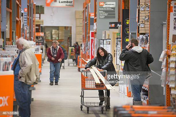 Customers shop for home improvement products at a Home Depot store on March 24 2015 in Chicago Illinois The Labor Department reported the...