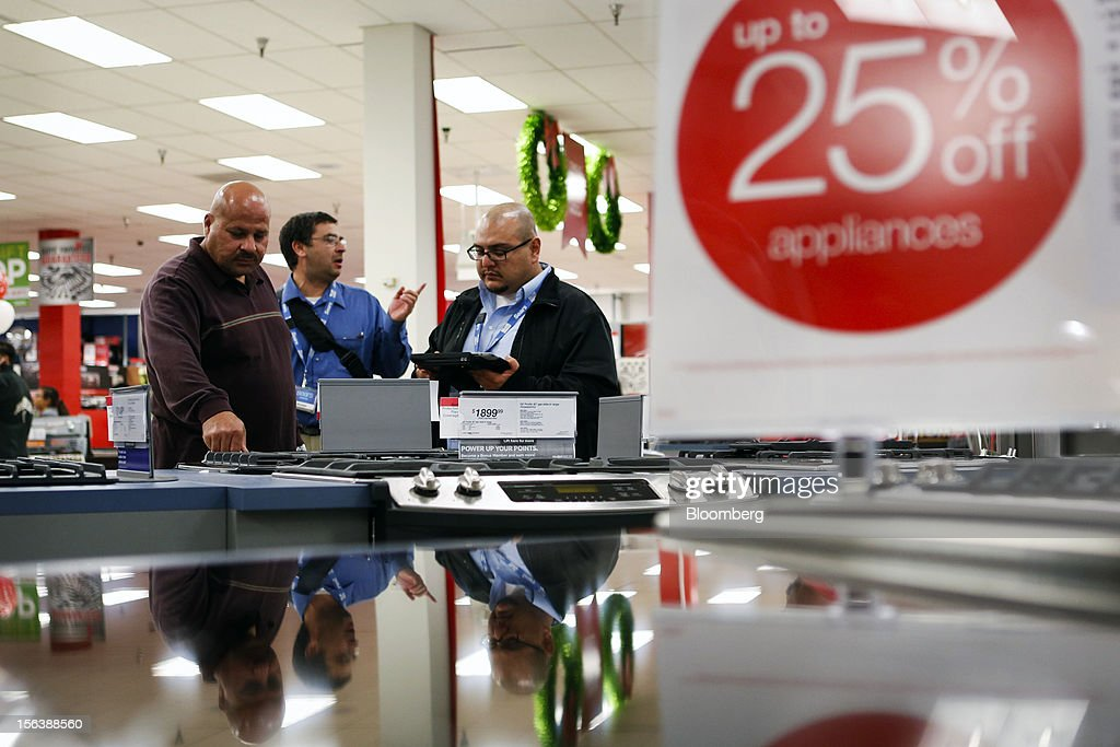 Customers shop for kitchen appliances at the Sears store during the Family and Friends evening sale inside the Del Amo shopping mall in Torrance, California, U.S., on Sunday, Nov. 11, 2012. Sears Holdings Corp. is scheduled to announce earnings results on Nov. 15 before the opening of U.S. financial markets. Photographer: Patrick Fallon/Bloomberg via Getty Images