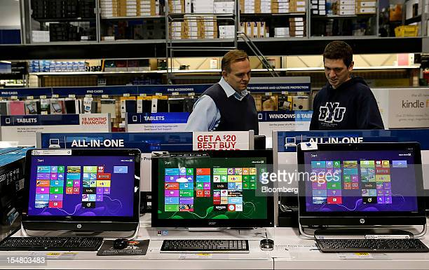 Customers shop for laptops running Microsoft Corp Windows 8 operating systems at a Best Buy Co store in Orem Utah US on Friday Oct 26 2012 Microsoft...