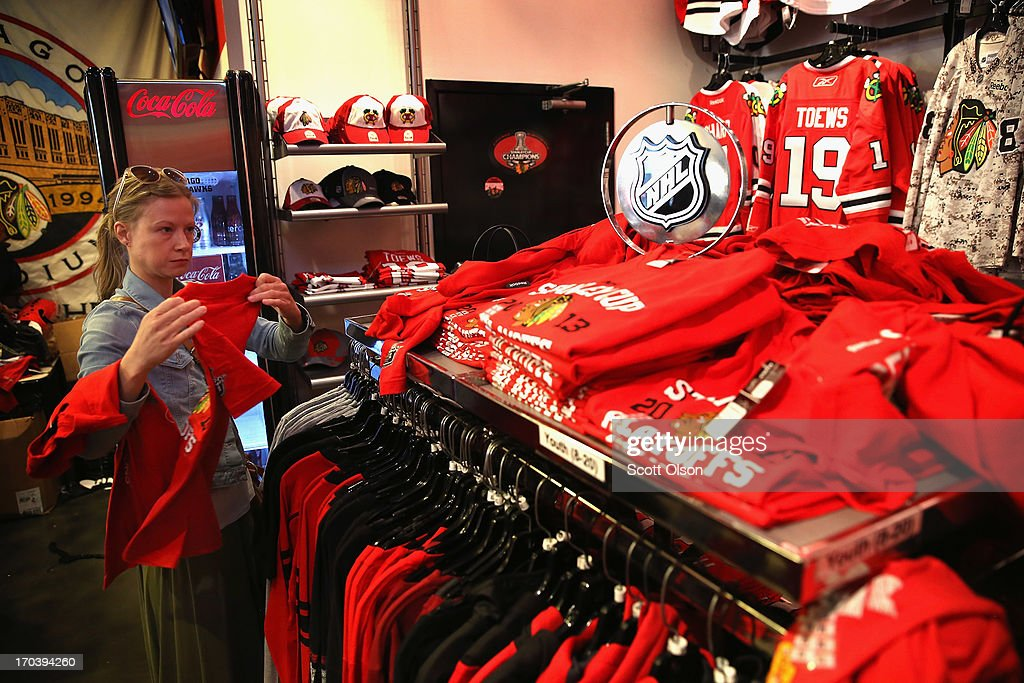 Customers shop for merchandise in the Blackhawks Store on Michigan Avenue in the Loop on June 12, 2013 in Chicago, Illinois. The Chicago Blackhawks will match up against the Boston Bruins tonight at the United Center in the first game on the NHL Stanley Cup playoffs.