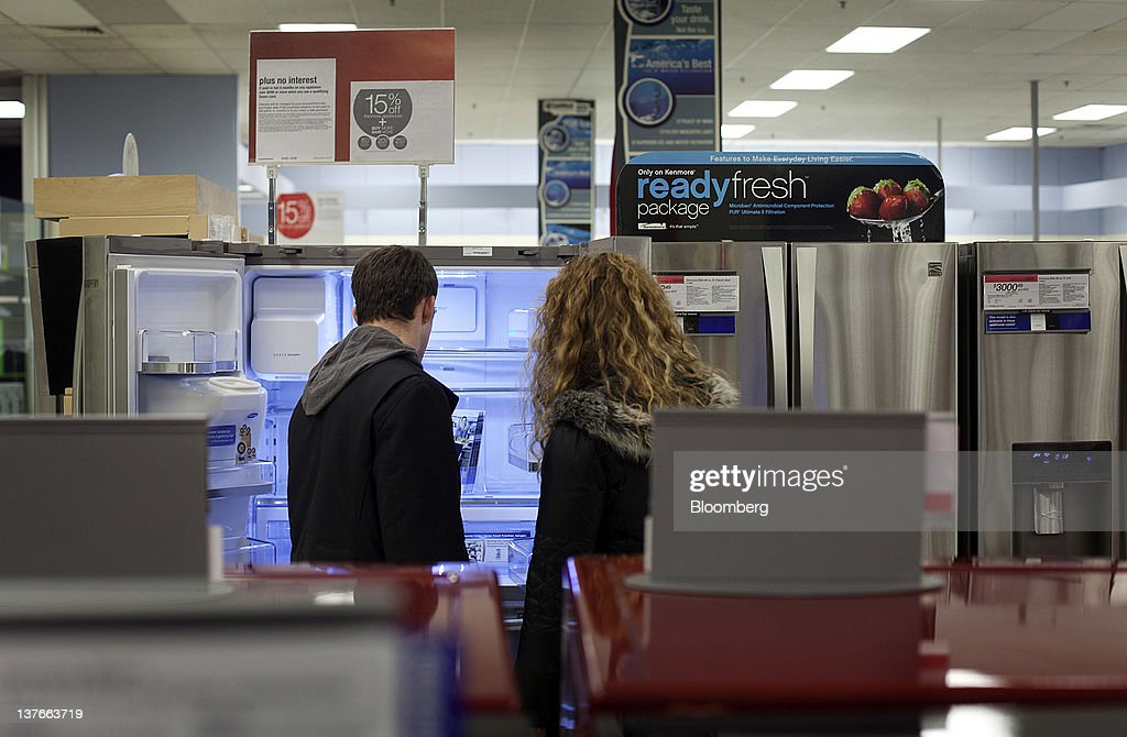 Customers shop for refrigerators at a Sears Holdings Corp. store in Jersey City, New Jersey, U.S., on Tuesday, Jan. 24, 2012. The U.S Census Bureau is scheduled to release durable goods data on Jan. 26. Photographer: Victor J. Blue/Bloomberg via Getty Images