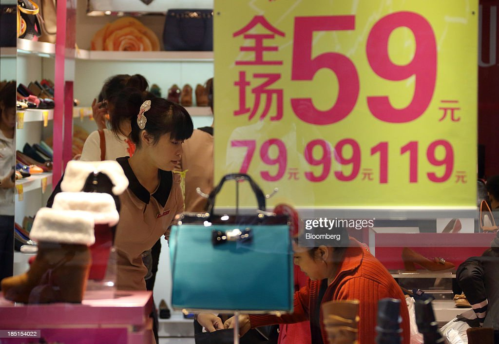 Customers shop for shoes and handbags inside a store in Wuhan, China, on Thursday, Oct. 17, 2013. China is scheduled to release third-quarter gross domestic product figures on Oct. 18. Photographer: Tomohiro Ohsumi/Bloomberg via Getty Images
