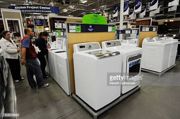 Customers shop for washers and dryers at Lowe's October 27 2011 in Burbank California Spending on durable goods and cars helped boost third quarter...