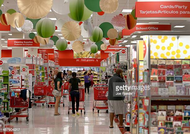 Customers shop in a Target store on December 19 2013 in Miami Florida Target announced that about 40 million credit and debit card accounts of...