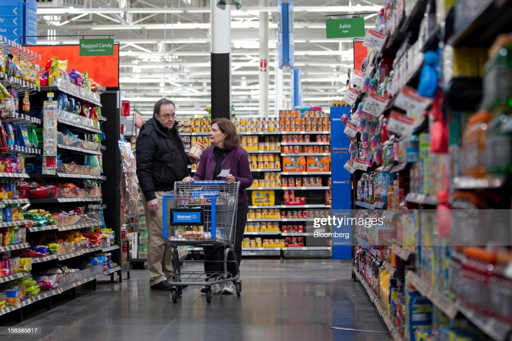 Customers shop in the grocery section at a Wal-Mart store in Alexandria, Virginia, U.S., on Wednesday, Nov. 14, 2012. Wal-Mart Stores Inc. is scheduled to release earnings data on Nov. 15. Photographer: Andrew Harrer/Bloomberg via Getty Images