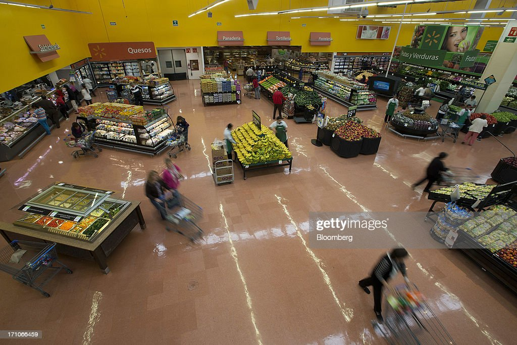 Customers shop in the grocery section of a Wal-Mart Stores Inc. location in Mexico City, Mexico, on Thursday, June 20, 2013. Mexican retail sales rose 2.5 percent in April from the same month last year, the country's statistics agency, known as Inegi, reported on its website. Photographer: Susana Gonzalez/Bloomberg via Getty Images