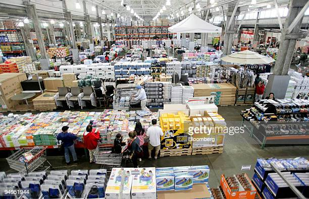 Customers shop inside a Costco store in Queens New York US on Thursday May 28 2009 Costco Wholesale Corp the largest US warehouseclub chain said...