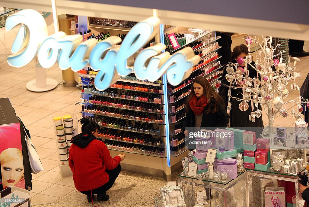 Customers shop inside a Douglas cosmetics store during Christmas shopping season in a shopping mall on December 8, 2012 in Berlin, Germany. German consumer confidence dropped prior to the Christmas season from a high level, according to a survey released at the end of November, expecting to harm retail sales in December, but not to the point of hurting businesses greatly.