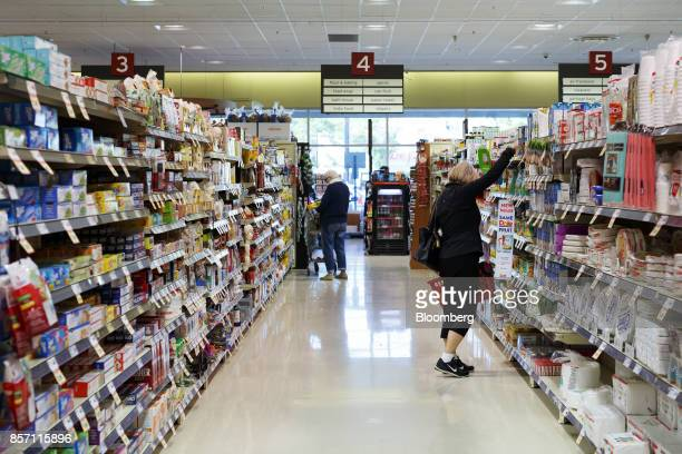 Customers shop inside a Metro Inc grocery store in Toronto Ontario Canada on Monday Oct 2 2017 Canadian grocer Metro Inc agreed to buy pharmacy chain...