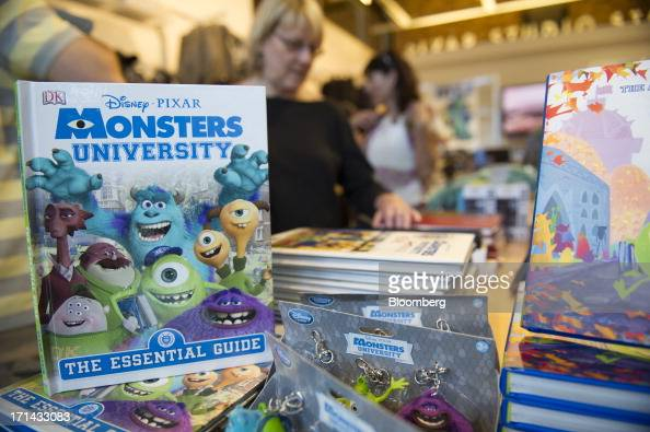 Customers shop inside the gift store at the Pixar Animation Studios headquarters in Emeryville California US on Friday June 21 2013 Walt Disney Cos...