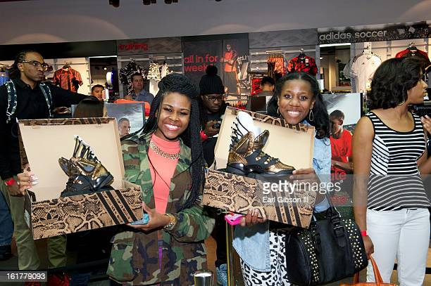 Customers show off the latest shoe designs by Teyana Taylor at the Adidas Store in the Galleria Mall on February 15 2013 in Houston Texas