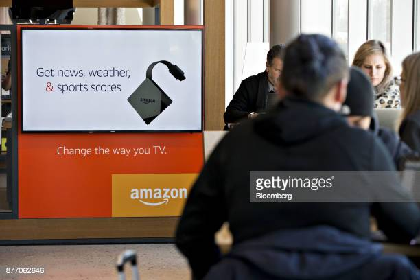 Customers sit at tables near an Amazoncom Inc PopUp store inside the Lakeview Whole Foods Market Inc store in Chicago Illinois US on Monday Nov 20...