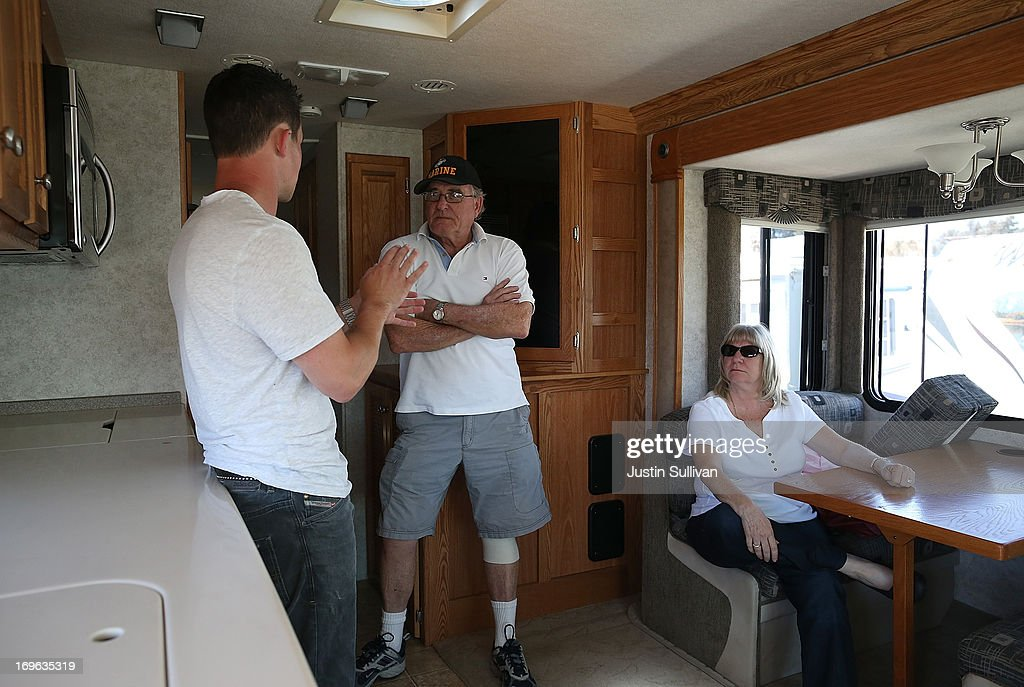Customers sit in an RV as they talk with a salesman at Cordelia RV on May 29, 2013 in Fairfield, California. Deliveries of motor homes and towable RVs to dealers surged 11 percent in the first quarter and the RV industry anticipates a total of 307,300 units will be shipped this year, the highest number since 2007.