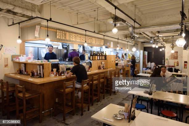 Customers sit inside a Kushikatsu Tanaka restaurant operated by Kushikatsu Tanaka Co in Tokyo Japan on Thursday April 20 2017 Kushikatsu...
