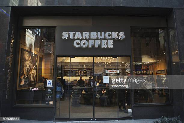 Customers sit inside a Starbucks Corp coffee shop in New York US on Monday Jan 18 2016 Starbucks Corp is scheduled to release its firstquarter...