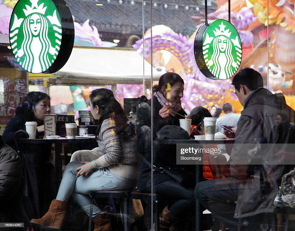 Customers sit inside a Starbucks Corp. outlet in Shanghai, China, on Thursday, Feb. 7, 2013. China's consumer prices rose 2 percent in January from a year earlier while the producer-price index dropped 1.6 percent, the National Bureau of Statistics said today in Beijing. Photographer: Tomohiro Ohsumi/Bloomberg via Getty Images