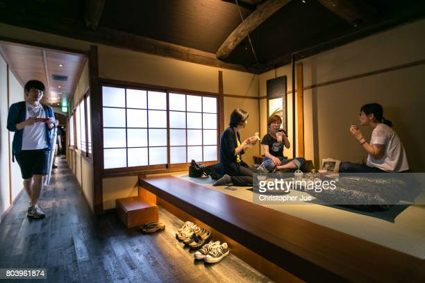 Customers sit inside Kyoto's new Starbucks branch on grand opening day on June 30 2017 in Kyoto Japan On June 30 Starbucks Coffee Japan Ltd opens the...