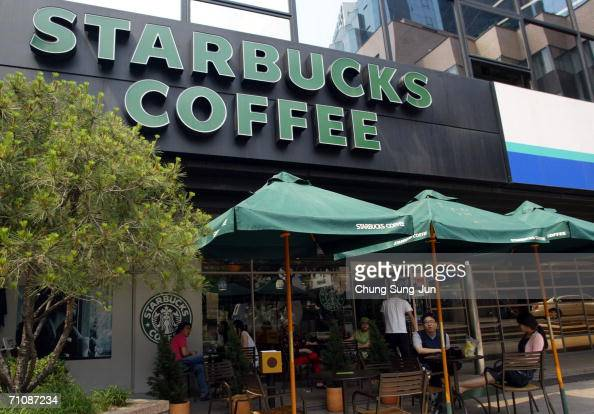 Customers sit outside a Starbucks coffee store on May 31 2006 in Seoul South Korea The National Tax Service has launched its first Tax audit of...