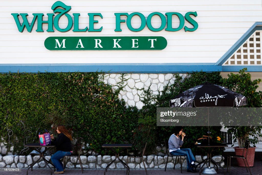 Customers sit outside of a Whole Foods Market Inc. location in Redondo Beach, California, U.S., on Tuesday, Nov. 5, 2013. Whole Foods Market Inc. is scheduled to release earnings figures on Nov. 6. Photographer: Patrick T. Fallon/Bloomberg via Getty Images