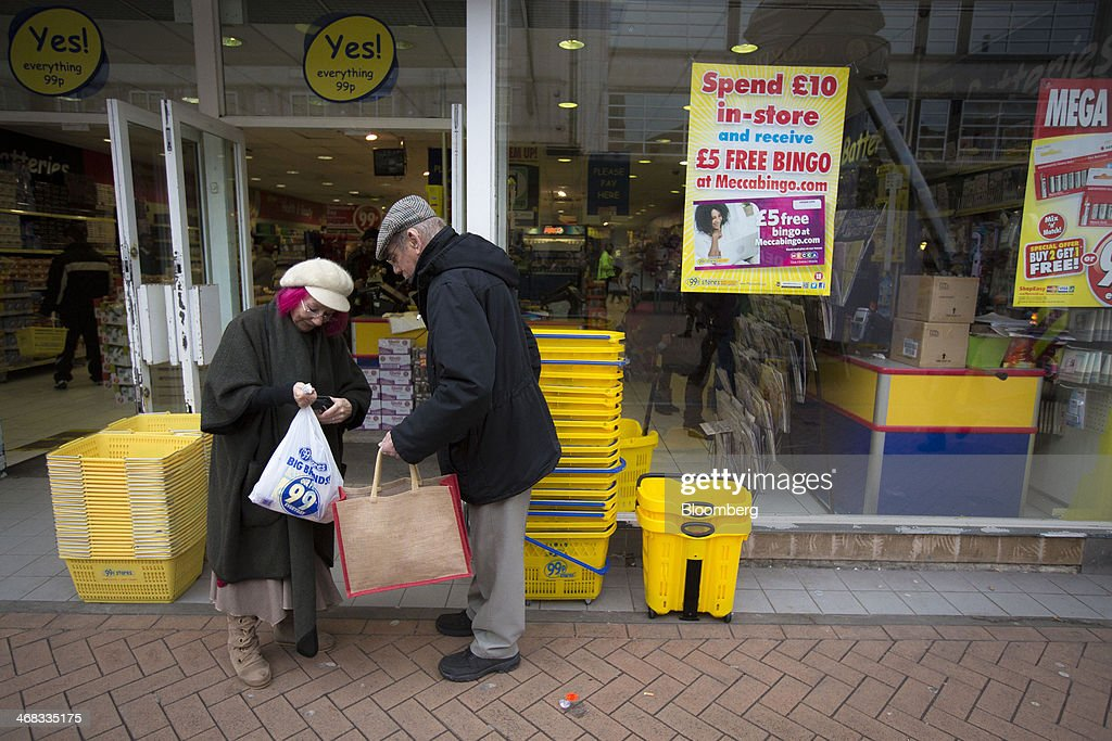Customers sort their shopping bags outside a discount store, operated by 99P Stores Ltd. in Croydon, south London, U.K., on Monday, Feb. 10, 2014. Westfield Group, Australia's biggest mall operator, and Hammerson Plc won preliminary approval to rebuild the Whitgift Centre mall in south London as part of a project valued at about 1 billion pounds ($1.6 billion). Photographer: Jason Alden/Bloomberg via Getty Images