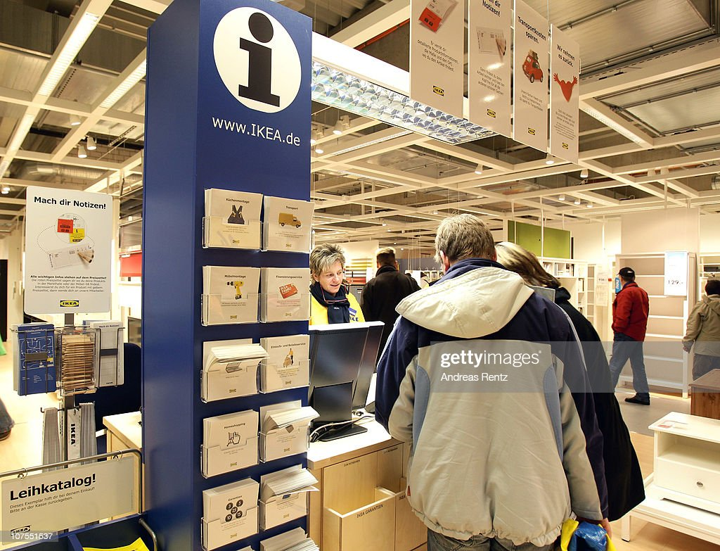 customers speak to an employee at an information stand during an opening ceremony at the 4th. Black Bedroom Furniture Sets. Home Design Ideas