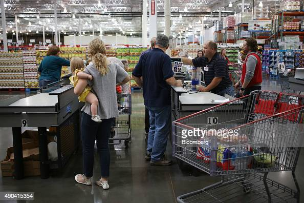 Customers stand at check out counters after shopping inside a Costco Wholesale Corp store in Nashville Tennessee US on Friday Sept 25 2015 Costco...