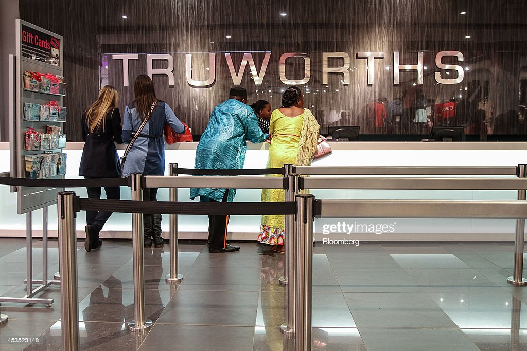 Customers stand at the check out counter inside a Truworths International Ltd fashion store in Sandton South Africa on Tuesday Aug 12 2014 South...