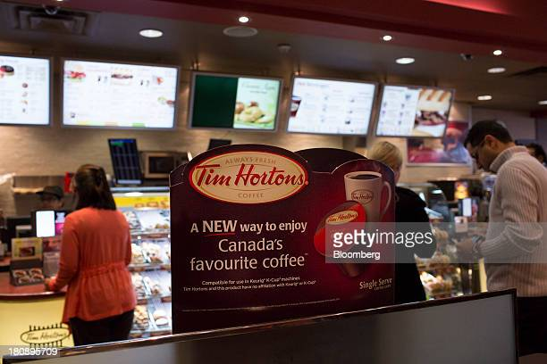 Customers stand in line at a Tim Hortons Inc restaurant in Toronto Ontario Canada on Tuesday Sept 17 2013 Tim Hortons Inc Chief Executive Officer...