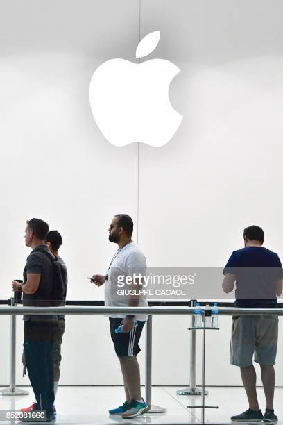 Customers stand in line to purchase the new Apple iPhone 8 at Dubai Mall Apple Store in Dubai on September 23 2017 The new Apple iPhone 8 and 8 Plus...