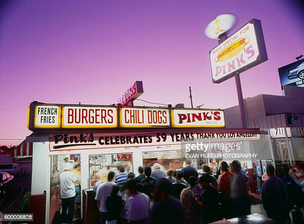 Customers stand in long lines to eat at Pink's hot dog stand at 709 N La Brea Avenue in Los Angeles The famous eatery was founded in 1939 and is best...