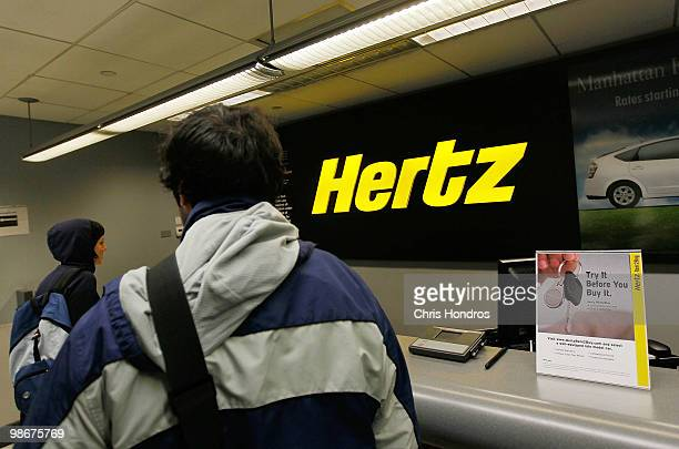 Customers stand in the lobby of a Hertz car rental location April 26 2010 in New York City Hertz Global Holdings Inc has announced that it will buy...